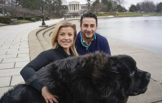 The happy couple ... or trio. Former Buffalo broadcasters Jonah Javad and Nalina Shapiro were engaged over the weekend. That's their Newfoundland, Bogey in a photo taken before they left for new lives in Dallas. (Derek Gee/Buffalo News)