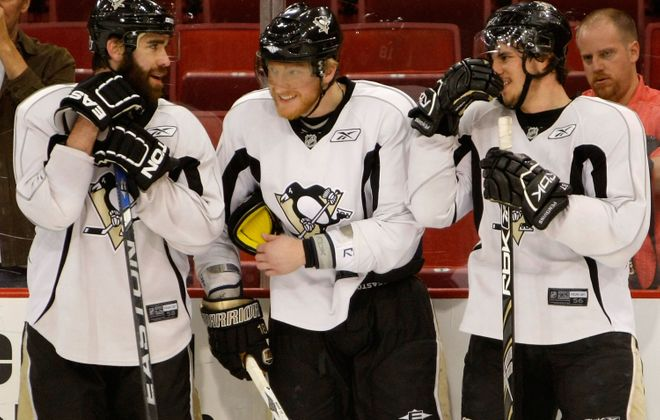 From left, Pittsburgh's Pascal Dupuis, Marian Hossa and Sidney Crosby chat it up during practice for the 2008 Stanley Cup final between the Penguins and Detroit Red Wings (Getty Images).
