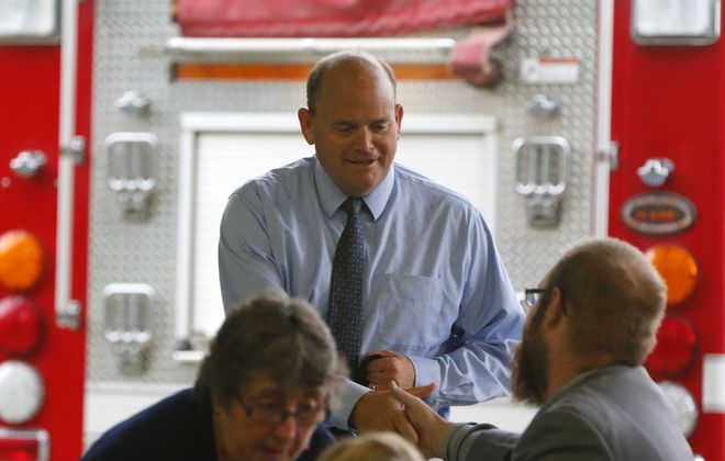 Rep. Tom Reed talks with his constituents during a town hall meeting at the Belfast Fire Hall in 2017.            (Mark Mulville/News file photo)