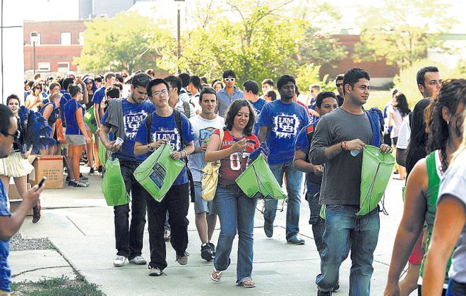 Students head to an event on the Amherst campus of the University at Buffalo on Aug. 24, 2012. (File photo/The Buffalo News}