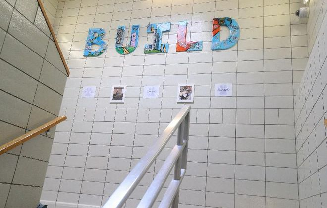 BUILD Academy's initials – for Build Unity, Integrity, Leadership, Dignity – adorn the walls inside the school. But it is likely to become BUILD Community School this fall under a makeover designed to improve student achievement. (John Hickey/Buffalo News file photo)