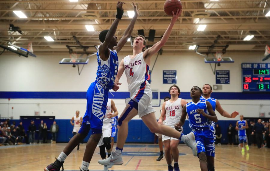 Williamsville South's Greg Dolan goes to the basket against Health Sciences' Davonte Gaines during the South's victory in 2018. (Harry Scull Jr./Buffalo News)