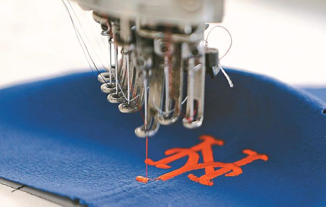 New Era Cap Co. spends millions fighting cap counterfeiters each year. (Mark Mulville/News file photo)