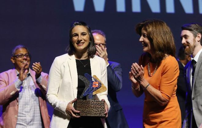 SomaDetect CEO Bethany Deshpande claiming the $1 million prize at 2017's 43North competition. (Sharon Cantillon/Buffalo News file photo)