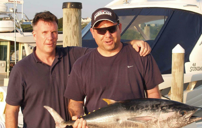 Todd Howe, left, and Joe Percoco, right, pictured after a 2010 fishing trip at Montauk Point at the tip of Long Island.