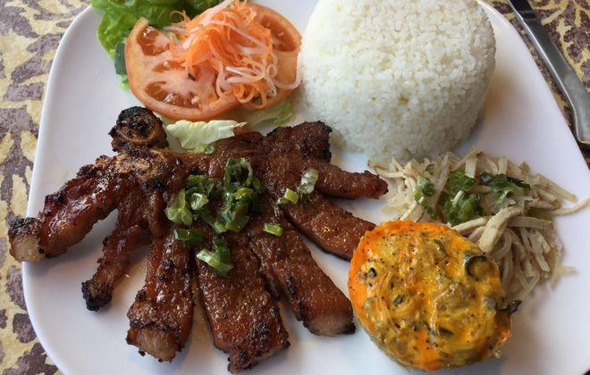 Pork chop, pork cake, sliced pork and rice plate at Pho Kim Chi. (Andrew Galarneau/Buffalo News)