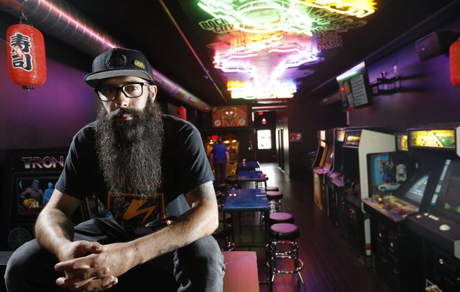 Heavy metal rocker Johny Chow has created an unusual restaurant and arcade with his new Misuta Chow's at 521 Main St. (Derek Gee/Buffalo News)
