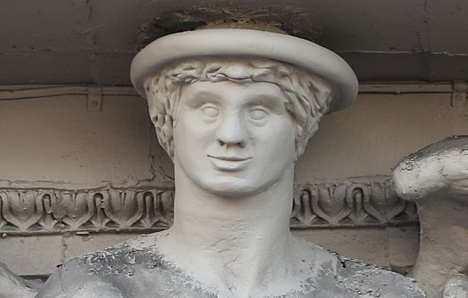 The new head of Mercury, crafted by Alphonso Butlak, at the  Ellicott Square, Washington Street entrance. (Sharon Cantillon/Buffalo News)