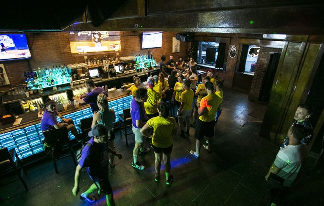 Teams from the Varsity Gay Kickball League hang out in Fierte with other patrons. (Shuran Huang/Buffalo News)