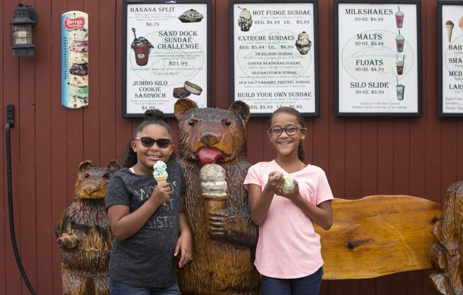 Ava Lytle, 10, and Remie Blanton, 7, from Hillsborough, North Carolina, enjoy their ice cream at The Silo in Lewiston. (Shuran Huang/Buffalo News)