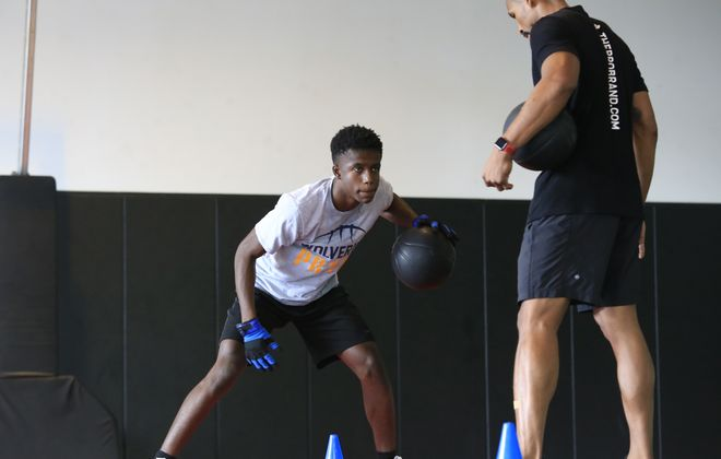 Willie Lightfoot, a  freshman basketball player at Niagara Falls High School, trains at Pro Training Basketball with University at Buffalo alum Rod Middleton. (Harry Scull Jr./Buffalo News)