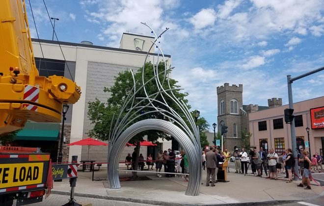 """Arch on Old Falls Street"" by Jesse Walp at its installation ceremony in Niagara Falls July 13, 2018. (Thomas J. Prohaska/The Buffalo News)"