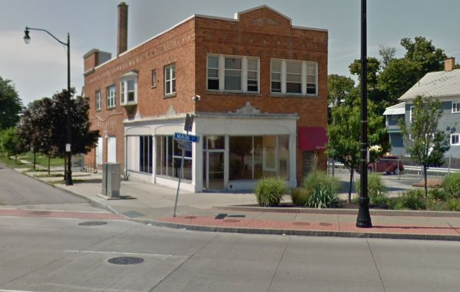 A Keller Williams real estate agent bought this commercial building on Main Street from an attorney.