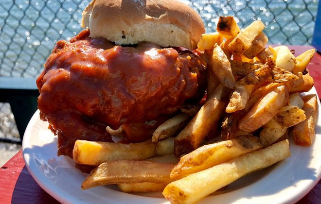Hoak's massive Buffalo chicken sandwich smothered in homemade wing sauce has been a standout on Hoak's Lakeshore menu for 30 years. (Elizabeth Carey/Special to The News)