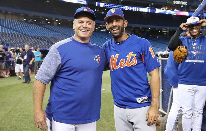 Jose Bautista, right, reunites with Blue Jays manager John Gibbons before his return game with the Mets on Tuesday in Toronto. (Getty Images)