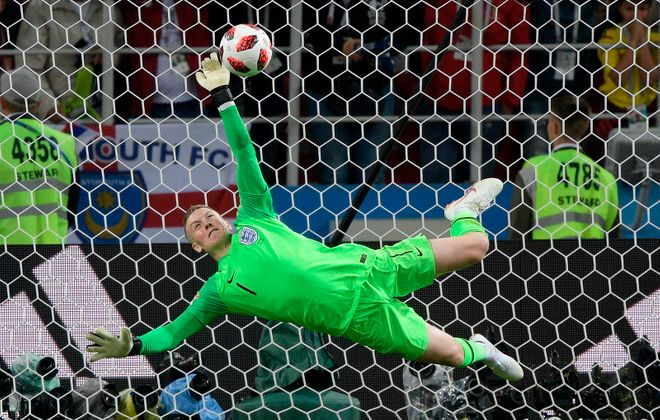 England men's national team goalkeeper Jordan Pickford makes a clutch save in the penalty kick shootout where his country knocked out Colombia. (Juan Mabromata/AFP/Getty Images)