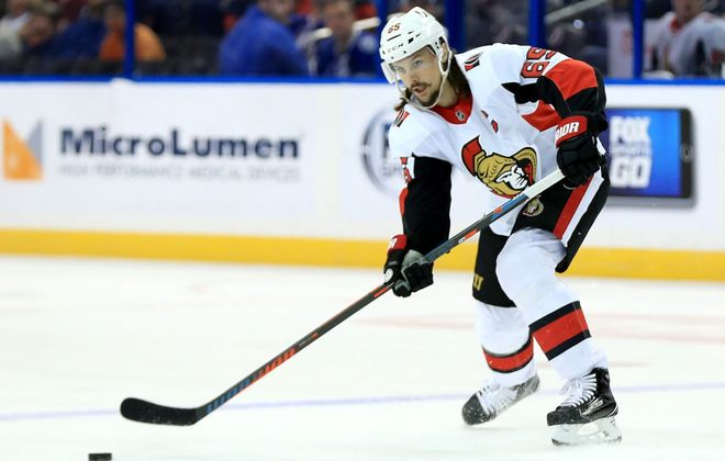 Erik Karlsson's next pass doesn't figure to be in Ottawa. (Getty Images)