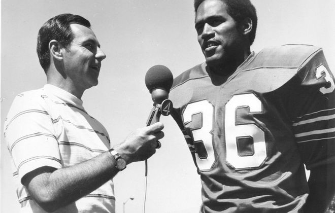 Wearing No. 36 instead of his famous 32, O.J. Simpson is interviewed by Channel 4's Van Miller during his first Bills training camp in 1969 at Niagara University. (News file photo)