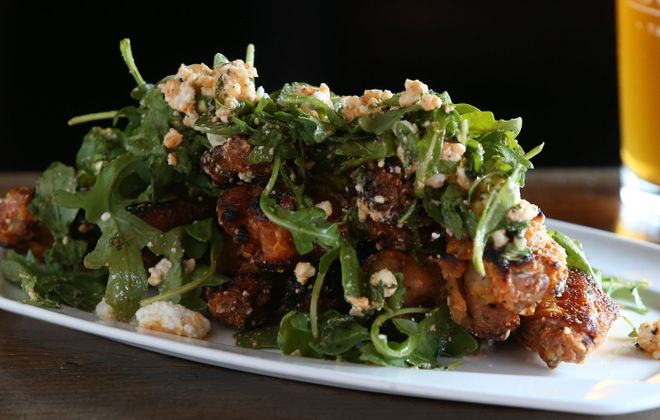 OP Social's Social wings are an unusual but tasty version of a Buffalo staple. (Sharon Cantillon/Buffalo News)