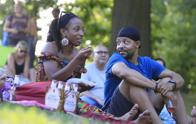 """Kia Pebnam and Anthony White enjoy a picnic dinner and a glass of wine prior to Shakespeare in Delaware Park's production of """"Much Ado About Nothing."""" (Harry Scull Jr./ Buffalo News)"""