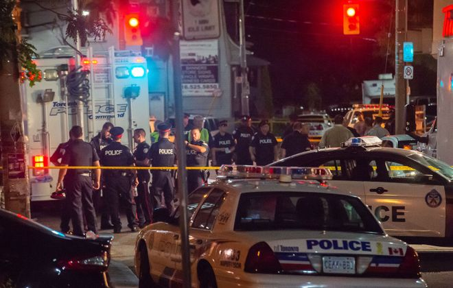 Police on the scene of a mass shooting after a gunman opened fire on Danforth Avenue West of Logan Avenue Sunday evening on Sunday, July 22, 2018, in Toronto. (Victor Biro/ZUMA Wire/TNS)