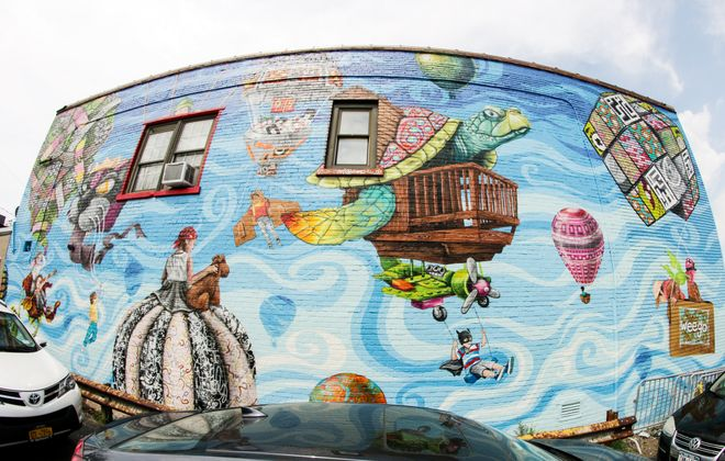 This new mural on Hertel Ave. took two weeks for the artists to complete. (Dave Jarosz)