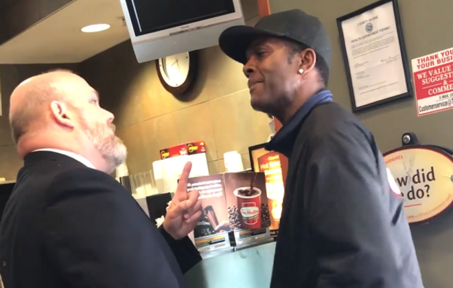 A still from a video posted to Facebook shows two men arguing in a downtown Tim Hortons. The confrontation is being compared to recent instances in which African-Americans were treated with disrespect. Whether that is also the case here will depend on details that are at this point unknown.