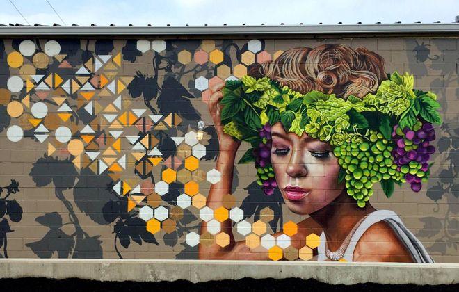 Chuck Tingley mural at Alchemy, a bottle store with food at 50 Buffalo St., Hamburg. (Ben Tsujimoto/Buffalo News)