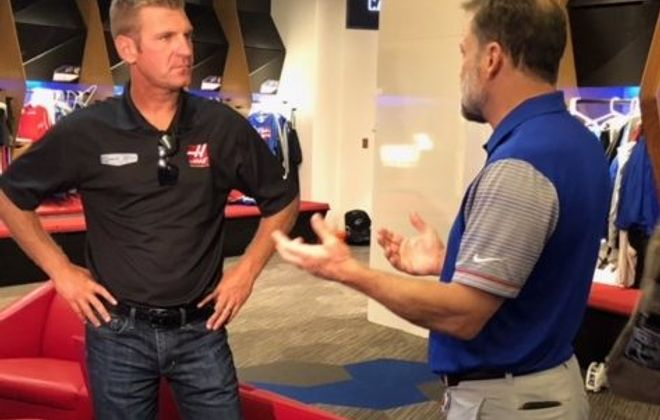 NASCAR driver Clint Bowyer got a tour of the Bills facility from Steve Tasker (Larry Ott, Buffalo News)