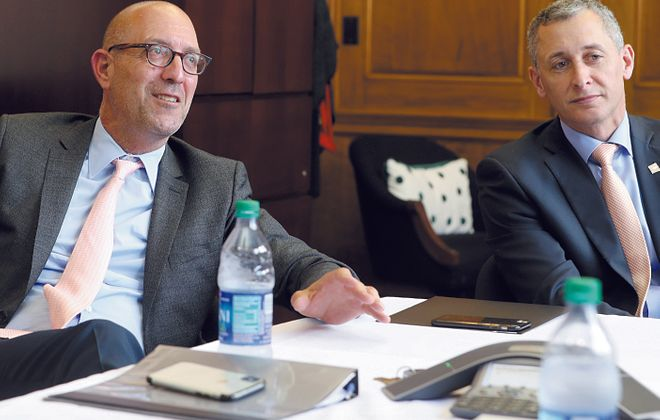 William Maggio, left, of 43North and Rene Jones of M&T Bank are supporting Ignite Buffalo., which will award grants to local businesses. (John Hickey/News file photo)