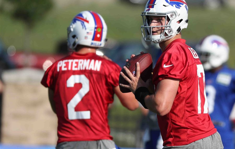 Rookie Josh Allen drew the biggest cheers, but it was Nathan Peterman who took the starting reps during the Buffalo Bills' first practice of training camp Thursday night at St. John Fisher College. (James P. McCoy/Buffalo News)