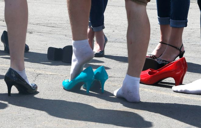 Men wear high heels for the Walk A Mile In Her Shoes for a march against gender violence from  Main Street and Hertel Avenue to Starin Avenue and back in Buffalo, N.Y., on Sunday, April 26, 2015.  (John Hickey/Buffalo News file photo)