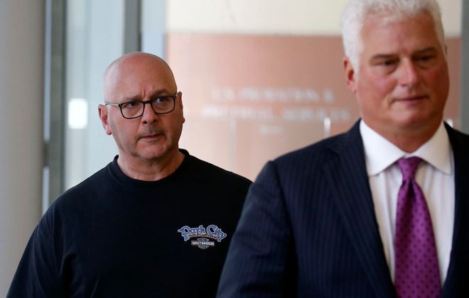Louis P. Ciminelli, left, gets escorted out of court with his attorney Daniel C. Oliverio after facing charges of  rigging and bribery at Buffalo federal court in 2016.  (Robert Kirkham/News file photo)