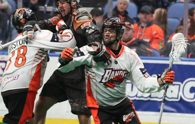 Bandits Jordan 	Durston blocks New England's Brett 	Manney while Bandits Mitch Jones takes a shot in the first quarter at Key Bank Center in Buffalo N.Y. on Saturday, March 31, 2018.  (James P. McCoy/Buffalo News)