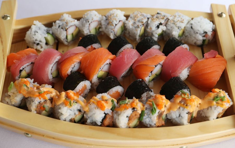 Camellia Garden offers four Sushi Boats. This is the Camellia Garden Boat One with California roll, spicy tuna roll, salmon roll and rainbow roll. (Sharon Cantillon/Buffalo News)