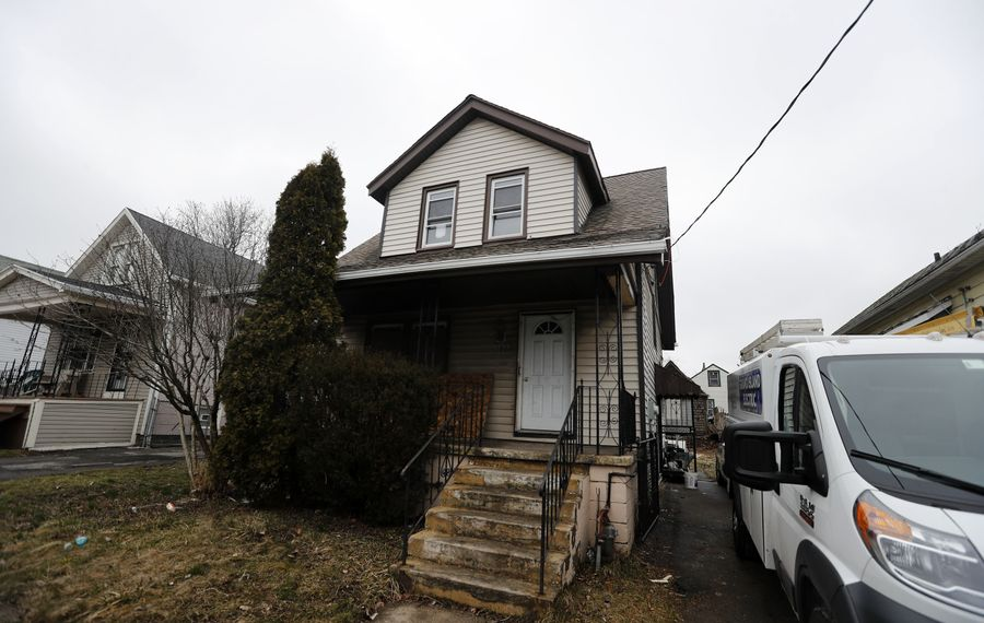 The Buffalo Erie Niagara Land Improvement Corp is doing a complete rehab of a small, vacant house at 107 Longview Ave., between Northland and East Delavan avenues.   (Mark Mulville/Buffalo News)