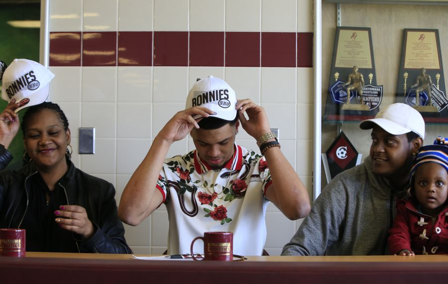 Cheektowaga alum Dominick Welch, with his mother Brandon and brother Darrell II and nephew Darrell lll, announces he'll play basketball at St. Bonaventure at Cheektowaga Central. (Harry Scull Jr./ Buffalo News)