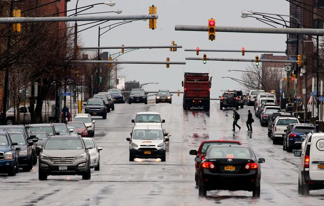 """A smart corridor along this stretch of Main Street, north of Goodell Street, could eventually have traffic lights that can """"talk"""" to vehicles or autonomous shuttles linked to Metro Rail arrivals and departures. (Derek Gee/Buffalo News)"""