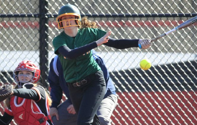 Williamsville North's Abby Vincent hits a liner during the Spartans' contest at Clarence on Thursday. (Harry Scull Jr./ Buffalo News)