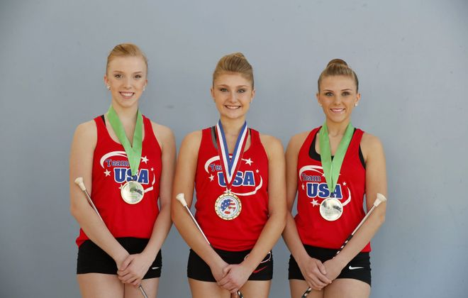 Baton Twirlers Morgan Proctor, left, Alexa Tamburlin, center, and Miranda Proctor, right, all won gold medals competing for team USA  in the world championship in Lillehammer, Norway.   (Mark Mulville/Buffalo News)