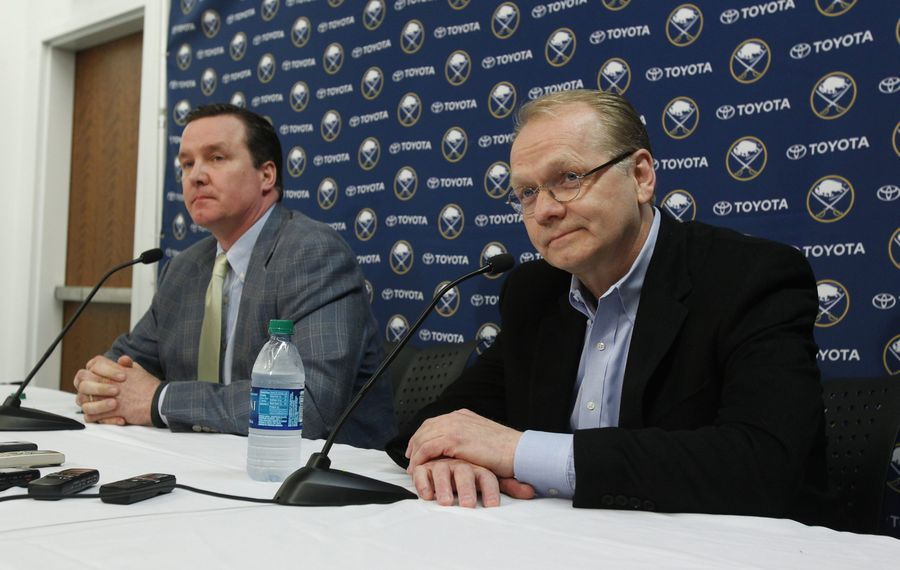 It was 46 minutes of madness when Ted Black, left, and Darcy Regier sat down in the Sabres' arena April 29, 2013. (News file photo)