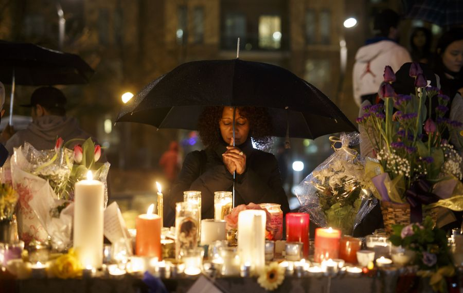 Senait Teclom attends a vigil for the victims of the mass killing on April 24, 2018, in Toronto. (Getty Images)