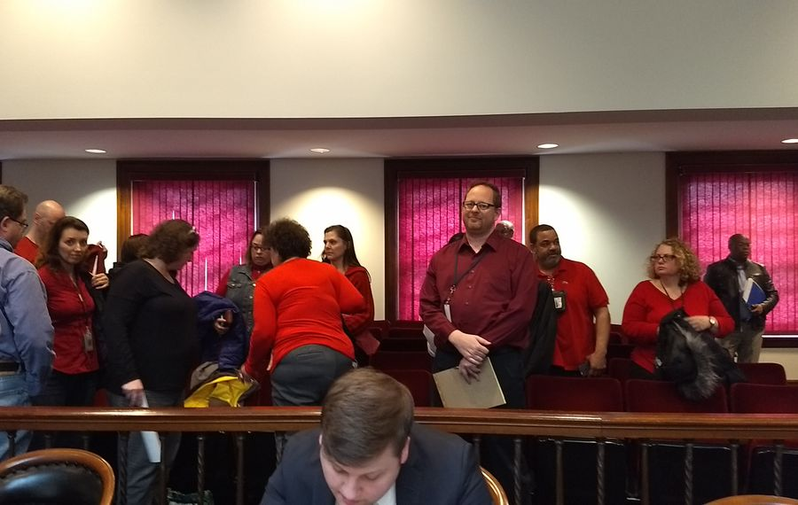 Child Protective Services workers, in red, at the Erie County Legislature meeting on Thursday. The employees have been coming to Legislature meetings lobbying for higher pay since August. (Sandra Tan/Buffalo News)