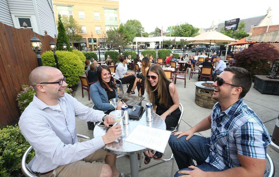 Enjoying the patio at Cecelia's Ristorante in 2015 is Randall Snodgrass, Kari Ann Boniface, Dorene Major and Eric Simm.   (Sharon Cantillon/Buffalo News)