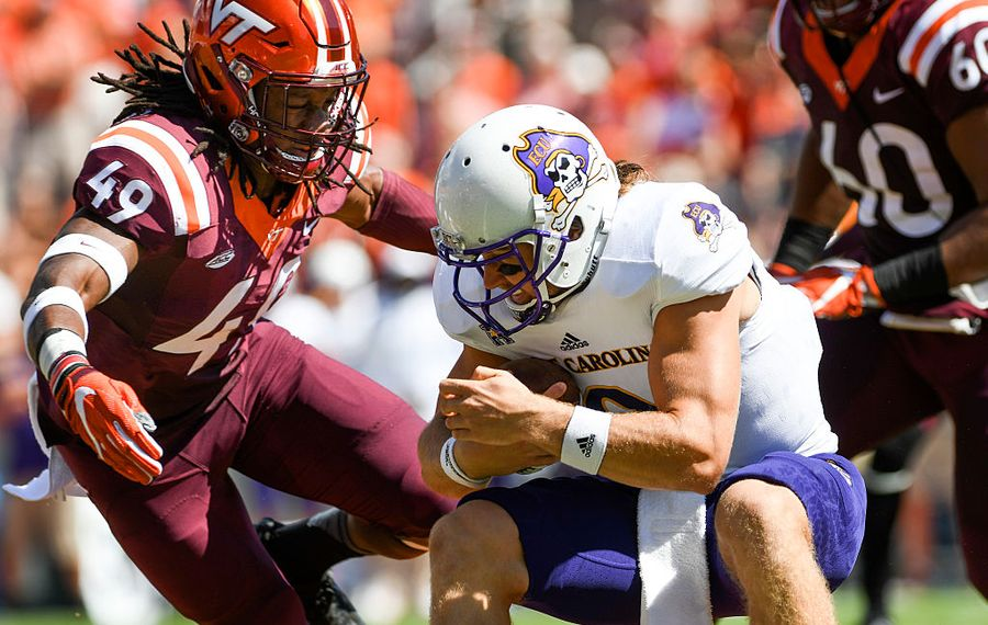 Linebacker Tremaine Edmunds #49 of the Virginia Tech Hokies prepares to hit quarterback Philip Nelson #9 of the East Carolina Pirates (Photo by Michael Shroyer/Getty Images)