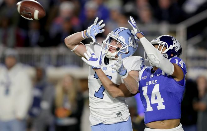 Austin Proehl (left) battles a Duke defensive back for a pass (Streeter Lecka/Getty Images)