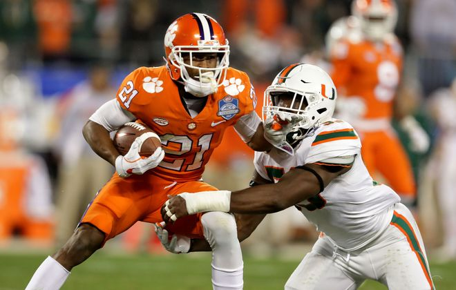 Ray-Ray McCloud #21 of the Clemson Tigers runs the ball against Zach McCloud #53 of the Miami Hurricanes in the second quarter during the ACC Football Championship at Bank of America Stadium on December 2, 2017 in Charlotte, North Carolina. (Getty Images)