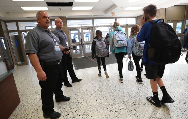 Michael Paternostro, left, a retired Kenmore police officer and Frank McNamara, a retired Town of Tonawanda police officer are Grand Island's new school resource officers. (Sharon Cantillon/Buffalo News)