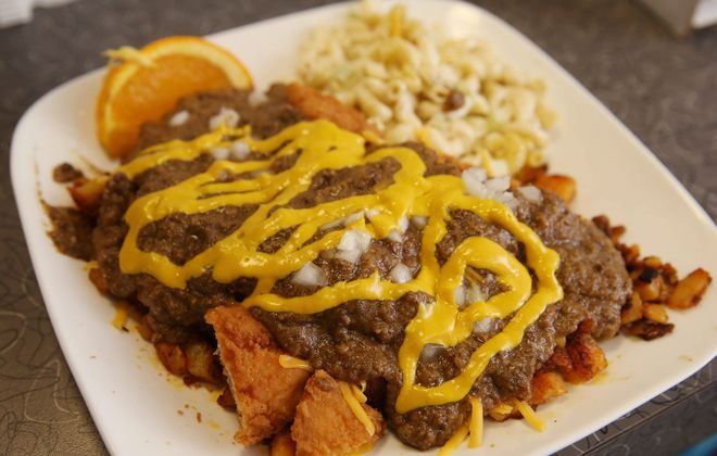 A Hangover Plate from Greek to Me is a close cousin in Buffalo to Rochester-based Nick Tahou Hots' Garbage Plate. (Sharon Cantillon/Buffalo News)