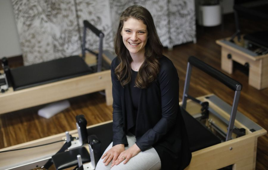 """""""There's a misconception that Pilates is all stretching and it's not,"""" says Hayley Sullivan, who started Long + Lean Pilates about five years ago. (Derek Gee/Buffalo News)"""